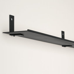"""Exposures - Invisible Display Ledge - Overview This picture ledge is so understated, it's almost invisible. The Invisible Display Ledge is sleek metal, with just enough lip for your items to lean against. Connector brackets (sold separately) add stability and allow you to mount two or more invisible wall shelves in a continuous, seamless, symmetrical line. Available in two colors to coordinate with your wall and frames. Features Made from metal Available in white or black Includes hanging template and hardware  Specifications Ledge measures 3' wide x 4"""" deep Shipping No Air Express shipping available for this item"""