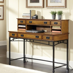 "Home Styles - Modern Craftsman Executive Desk with Hutch - Reminiscent of the American Craftsman Era with understated style and simplicity, the Modern Craftsman Executive Desk with Hutch by Home Styles marries a traditional finish on poplar solids with veneers and new age brown metal accents. The Modern Craftsman Executive Desk with Hutch is equipped with drawers, multi-function drop-down front center drawer with cable access; it can function as a keyboard tray or a large storage drawer. The desk is completely finished on all four sides. Features: -Drawers are side mounted with easy-glide metal drawer guides.-Equipped with drawers.-Hutch provides an abundance of storage with large middle drawer with side storage drawers.-Hutch drawers have side mounted wood guides for support.-Modern Craftsman collection.-Desk Type: Executive desk.-Top Finish: Distressed oak.-Powder Coated Finish: No.-Gloss Finish: No.-UV Finish: No.-Top Material: Wood.-Number of Items Included: 2.-Pieces Included: Desk and hutch.-Distressed: Yes.-Collection: Modern Craftsman.-Keyboard Tray: Yes.-Drawers Included: Yes.-Chair Included: No.-Commercial Use: No.-Product Care: Clean with damp cloth.-Swatch Available: No.-Recycled Content: No.Specifications: -FSC Certified: No.-CARB Compliant: Yes.-ISTA 3A Certified: Yes.Dimensions: -Overall Height - Top to Bottom: 42"".-Overall Width - Side to Side: 54"".-Overall Depth - Front to Back: 24"".-Cabinet: No.-Drawer: Yes.-Shelving: Yes.-Hutch: Yes.-Overall Product Weight: 180.40 lbs.Assembly: -Assembly Required: Yes."