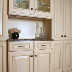 """Elegant Traditional Kitchen - Custom doors with 3-5/8"""" stiles and rails; Cabinets: Windham Cream Antiqued with Raw Umber glaze. Frameless construction. Detailed furniture baseboard. Cabinetry by Homestead Custom Cabinetry. Design by Jan Goldman of Kitchen Elements, Olney, MD"""