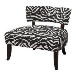 Powell Lady Slipper Zebra Print Accent Chair - Bold design elements can still be big on relaxation. Case in point: the Powell Lady Slipper Zebra Print Accent Chair. Crafted with a durable wood frame, this oversized, exotic chair gets drama from super-plush black and white zebra print upholstery. The high back is padded and tufted for extra comfort, and slightly curved, black-finished legs offer extra support.