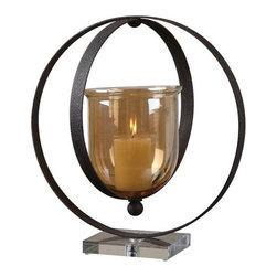 Uttermost - Matthew Williams Charon Metal Candle Holder - Dark, rust bronze metal rings suspend the transparent amber glass globe: All seated on a crystal base. Off-white candle included.