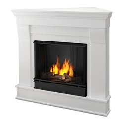 Real Flame - Chateau Corner Ventless Gel Fireplace in Whit - Uses clean burning Real Flame Gel fuel emitting up to 9,000 BTUs of heat per hour lasting up to 3 hours. Includes: Mantel, firebox, hand painted cast concrete log, and screen kit. Solid wood and veneered MDF construction.. Uses Only Real Flame 13oz Gel Fuel Cans, not included. Assembly Required. 40.9 in. W x 25.3 in. D x 37.6 in. H (65.4 lbs.)The Chateau Corner Fireplace features the clean lines and classic styling familiar to stone mantels, realized in wood. In three great finishes, this design is sure to compliment a variety of decor, from the classic to contemporary. The hand-painted log set and bright crackling flame add to the realistic look of this Real Flame Gel Fuel Fireplace. Uses 3-13oz cans of Real Flame Gel Fuel, not included
