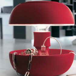 Lightology Collection - Joyo Soft Table Lamp - Joyo Soft is very pleasing to touch and lends a distinctive, elegant opaqueness to the lamp. The new power cable in color coordinated fabric adds an extra touch of elegance and modernity to the piece. Available in red, black, or white finish. Recharges your multimedia accessories thanks to three integrated USB sockets and acts as a convenient valet tray thanks to the storage compartments in the base. Also available in Joyo Light Colors and Joyo Classic versions. Supplied with 3.5 watt LED light source. 9.84W x 10.71H