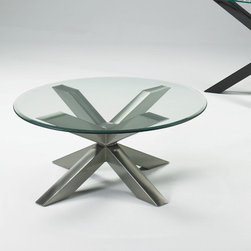 Johnston Casuals - Diva Coffee Table - Searching for the best contemporary theme out there? The Diva Glass Contemporary Coffee Table, featuring a one-of-a-kind intersecting contemporary design, is sure to exceed your expectations. With its clear glass table top, this contemporary coffee table is versatile enough to match any d cor. Individually hand-made in Johnston Casuals' USA factory, you can be sure this coffee table will provide years of lasting quality and aesthetic appeal. This contemporary coffee table looks great on its own, but looks even better as part of a coffee table set with the matching end tables and console table! Features: -Individually hand-crafted in the USA.-Clear glass table top.-One-of-a-kind intersecting contemporary design.-High quality powder-coat metal construction.-Johnston Casuals Diva collection.-Please note: This item is made to order. As such, orders cannot be cancelled after 15 days..-More customization options may be available for an additional charge. Also, please be aware that as each item is created individually, slight variations in finish and shape may occur..-Collection: Diva.-Distressed: No.-Country of Manufacture: United States.Dimensions: -Overall dimensions: 18'' H x 42'' W x 42'' D.-Overall Product Weight: 150 lbs.Warranty: -10-Year structural failure warranty on metal frame.