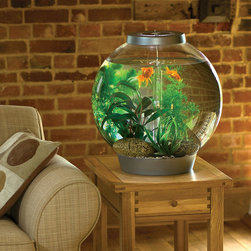 "Frontgate - BiOrb 8-gallon Aquarium - Plexiglass acrylic globe is clearer and 10 times stronger than glass. Generously sized orbs provide a great environment for fish with more swimming space than a traditional fish bowl. A combination of 5 biological, mechanical, and chemical filtration stages keep water crystal clear and free of pollutants. Can go several months between filter changes. Filtration system and air pump are almost completely concealed in the bottom of the orb. A beautiful example of living art, the BiOrb Aquariums combine the clean, modern look of a traditional fish bowl with the performance of a high-tech aquarium. The unique shape of the BiOrb gives you an unobstructed 360&#176 view of your fish in an environment that's free of wires, tubes, and other distractions.  . . . . . Low voltage 10-watt halogen bulb is hidden inside the lid and provides beautiful illumination for the entire tank. A single transformer simplifies the set-up by providing 12 volts of power to both the air pump and light. Suitable for both tropical or cold water fish. ""Swap Tops"" let you change the look of your BiOrb to match its surroundings."
