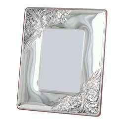 "Silverstar International - 8""x10"" Bijou Silver Sterling Frame - The Bijou silver keepsake is a handcrafted 925 solid embossed repousse sterling silver frame with an intricate floral design embossed in the upper left and lower right corners. It comes with a rich mahogany back with slide tab closures that ensure easy access to your precious photographs. It makes a lovely wedding photo frame and is an excellent choice for a 25th anniversary gift.Every Silverstar picture frame is designed with a tarnish resistant surface for easy cleaning and glare resistant glass."