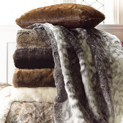 Frontgate - Estate Luxury Faux Fur Throw - Whether placed on your bed, chair or sofa, this throw adds a dash of sophisticated elegance to your home, and makes an excellent gift. Recreates the look of real fur without harming any animals. Part of our that includes many coordinating pillows. Makes an excellent gift and arrives in an elegant gift box. Saves energy by keeping you warm while relaxing with a good book or lounging in a chair. Thicker and larger than similar faux fur throws, our Luxury Faux Fur Estate Throw replicates the irresistible softness, warmth, and luxury of real fur that you can appreciate anywhere. Densely woven using the most innovative fibers, it is also remarkably practical, and is now available in a larger size.. . . . . Fur is densely woven to 700 grams per square meter of 85% acrylic/15% polyester. Lined with plush polyester fleece for added warmth and comfort. Channeled Mink color features channeled seam construction. Easy-care, machine-washable convenience. Machine wash cold, gentle cycle; line dry. Imported.