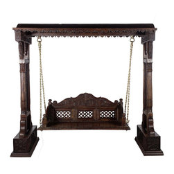 Wooden Jali Swing With Brass Chain - Elegant back carvings and front decorative design is remanence of the culture Jadejas of Gujarat from 9th century. These carvings were especially found in the vacation homes of the royals. These swing sets are found in the balconies and patios in front of the royal garden palaces of Gujarat. The back design has been carefully crafted to provide the artistic look while providing utmost comfort. The pillars are strong and structurally tested to provide a stable and safe seating. It can be used in a room, loft, patio or balcony area. The brass  chains are rust free to last long,