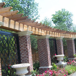 Southwest Fence & Deck Arbor - We specialize in these impressive and stately structures that are a lovely addition to any landscape. The perfect complement to a poolside deck or patio, arbors create shade and protection from the hot Texas sun along with elegant privacy when hung with wisteria or other flora. Outdoor lighting, fans, misters and heaters allow for optimal utilization of your outdoor oasis regardless of the time of day or the extremes of the weather.