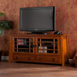Southern Enterprises Scollis TV / Media Stand - Give your family room a tasteful, Asian-inspired makeover with the Southern Enterprises Scollis TV / Media Stand. This piece is crafted of solid wood with decorative veneers drenched in a warm, mahogany finish with detailed bronze hardware and ample storage. It features two glass paneled doors that each open to reveal an adjustable shelf for electronics, consoles, movies, and games. Two wide drawers below offers extra storage possibilities.About SEI (Southern Enterprises, Inc.)This item is manufactured by Southern Enterprises or SEI. Southern Enterprises is a wholesale furniture accessory import company based in Dallas, Texas. Founded in 1976, SEI offers innovative designs, exceptional customer service, and fast shipping from its main Dallas location. It provides quality products ranging from dinettes to home office and more. SEI is constantly evolving processes to ensure that you receive top-quality furniture with easy-to-follow instruction sheets. SEI stands behind its products and service with utmost confidence.