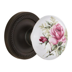 "Nostalgic - Nostalgic Privacy-Rope Rose-Rose Porcelain Knob-Oil-Rubbed Bronze (NW-711199) - Blending rich detail and subdued refinement, the Rope Rosette in oil rubbed bronze captures a style that has been a favorite for centuries. And, nothing says ""vintage"" like the traditional floral illustration of the White/Rose Porcelain Knob. All Nostalgic Warehouse knobs are mounted on a solid (not plated) forged brass base for durability and beauty."