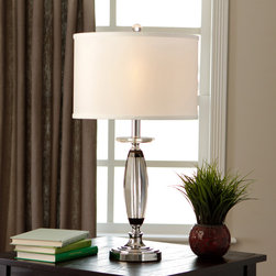 None - Dalin Crystal Table Lamp - This elegant table lamp features a chrome finish that is partially encased in a lovely curved clear casing. The shade's white fabric helps add brightness to the accompanying illumination.