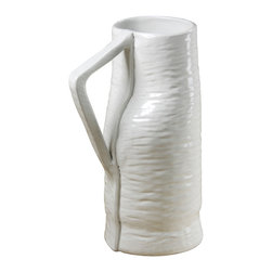 Montes Doggett - Handmade Tall Pitcher - This beautiful pitcher would be perfect for mixing up cocktails on a summer afternoon. It's tall enough to serve several guests and would look great sitting on a bar alongside some chic glassware. Of course, it would look just as good holding a tall bouquet of flowers, if cocktails aren't your thing!