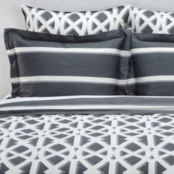 Z Gallerie - Elton Bedding - Revise your room with an interpretation of an interlocking geometric print with our supremely stylish Elton Bedding.  Our brilliant white pattern comes alive by soft grey shadowing, all of which is juxtaposed atop a saturated hue, making for a dimensional and striking bedding collection. For limitless decorating options, each sham, euro sham and duvet is complemented by horizontal stripes on the reverse. Stunning against crisp white sheets, our Elton Bedding is equally impressive when paired with complementary throw pillows.  Available in Charcoal and Sapphire. Sold separately.