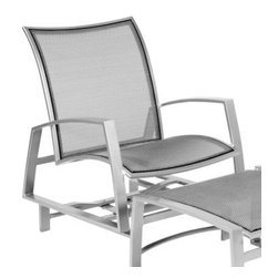 Woodard Wyatt Flex Spring Lounge Chair - When it comes to making the most of glorious summer weather, nothing can top the Woodard Wyatt Flex Spring Lounge Chair. Combining contemporary elegance, timeless appeal, and a simple, clean design, this chair blends well with any patio setting, while the oversized seat, supportive back, and gentle back-and-forth rocking movement envelop you in luxurious comfort for hours on end. And the best part is that unlike traditional sling design, which is sandwiched between the external frame, Wyatt sling is attached to a secondary internal frame, allowing for more flexibility and imparting a sleeker, more stylish look.Designed to withstand frequent use and the harshest elements, the sturdy, fully-welded aluminum frame is available in a choice of powder-coated finishes that will not rust, peel, or blister over the years. The quick-dry texteline sling comes in many options, making this chair the perfect choice for the poolside. What's even better is that it is virtually maintenance-free and hoses off to clean, letting you spend all your free time relaxing outdoors. Made by Woodard, the leader in quality patio furniture for 140 years, this super-comfy lounge chair offers the perfect mix of style, comfort, and function.Important NoticeThis item is custom-made to order, which means production begins immediately upon receipt of each order. Because of this, cancellations must be made via telephone to 1-800-351-5699 within 24 hours of order placement. Emails are not currently acceptable forms of cancellation. Thank you for your consideration in this matter.For over 140 years, Woodard craftsmen have designed and manufactured products loyal to the timeless art of quality furniture construction. Using the age-old art of hand-forming and the latest in high-tech manufacturing, Woodard remains committed to creating products that will provide years of enjoyment.Superior Materials for Lasting DurabilityIn the Aluminum Collections, Woodard's trademark for excellence begins with a core of seamless, virgin aluminum: the heaviest, purest, and strongest available. The wall thickness of Woodard frames surpasses the industry's most rigid standards. Cast aluminum furniture is constructed using only the highest grade aluminum ingots, which are the purest and most resilient aluminum alloys available. These alloys strengthen the furniture and simultaneously render it malleable. The end result is a fusion of durability and beauty that places Woodard Aluminum furniture in a league of its own.Fabric, Finish, and Strap Features All fabric, finish, and straps are manufactured and applied with the legendary Woodard standard of excellence. Each collection offers a variety of frame finishes that seal in quality while providing color choices to suit any taste. Current finishing processes are monitored for thickness, adhesion, color match, gloss, rust-resistance and, and proper curing. Fabrics go through extensive testing for durability and application, as well as proper pattern, weave, and wear.Together, these elements set Woodard furniture apart from all others. When you purchase Woodard, you purchase a history of quality and excellence, and furniture that will last well into the future.