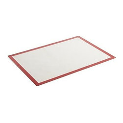 Baking Mat - Used in place of parchment to help prevent sticking or burning, this flexible modern mat of silicone-coated fiberglass turns any cutting surface or pan into an easy-release, non-stick surface for dough prep and baking. Mat may be placed directly on the oven rack, cleans up in the dishwasher, and rolls up for compact storage.