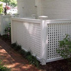 Lattice Enclosure with LifeGuards - Enhance your outdoor area with horizontal/vertical lattice that enclose and disguise A.C. units or garbage barrels. The addition of Walpole LifeGuards protects the post bases from termites or wet soil conditions, extending the life of your fence.