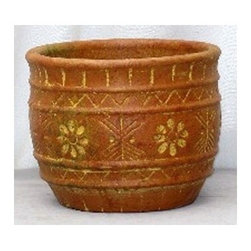 Mexican pot 07 - A very decorative basic flower planter that has lots of hand carved designs on the sides.  Each piece is hand thrown, rustic Mexican clay and fired in a traditional brick kiln
