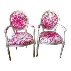French Chairs - A pair of vintage chairs refurbished with new, neon pink upholstery balances new and old. I imagine these at the head of a sleek dining room table.