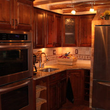 Mediterranean Kitchen Cabinets by Signature Cabinetry & Design Solutions