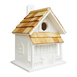"""Home Bazaar Inc - Country Cottage Birdhouse, White - The Country Cottage Birdhouse will remind you of a lakeside vacation home. Constructed of exterior grade ply-board, pine roof shingles and poly resin for detail and decorations. The swing-up mounting peg makes installation a snap. With a 1 1/4"""" opening, removable back wall, drainage, ventilation and an unpainted interior, there's no mistaking that this is a fully functional birdhouse."""
