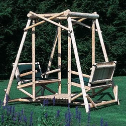 """Lakewood Swing - Our Lakewood Swing is perfect for your leisure area. Durable cedar log framework provides support for 4 adults. Frame height 6'-9"""", width 5'-10"""", length 7'-1"""". Seats between arms 39"""", platform to seat 14"""", depth 19"""". Wood canopy sold separately. Cushions sold separately. Shipped kit. Motor freight."""