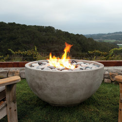The Infinite Fire Bowl - As the name implies, the Infinite is limitless in its design applications. The simple yet elegant shape will naturally draw attention for its style and inviting warmth. Perfect for both residential and commercial applications, Infinite can change appearance from modern to traditional by simply selecting the weathered & textured Travertine finish.