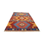 Multicolored 5'X7' Anatolian Kilim Hand Woven 100% Wool Flat Weave Rug SH4452 - Soumaks & Kilims are prominent Flat Woven Rugs.  Flat Woven Rugs are made by weaving wool onto a foundation of cotton warps on the loom.  The unique trait about these thin rugs is that they're reversible.  Pillows and Blankets can be made from Soumas & Kilims.