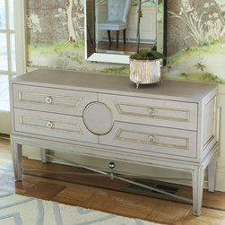 Collectors Console - Grey - A round element at the center of the Collector's Console's facade dictates the shape of the drawer faces around it, adding the sensuality of curve to a piece with simple, readily-adorned geometric lines.  Coffering, molding, and a delicate X-stretcher further detail this attractive chest, which is painted a creamy dove-grey perfect for inclusion as a sophisticated, timeless neutral tone.