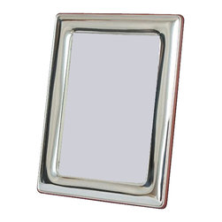 "Silverstar International - Aurelie Sterling Silver Picture Frame, Silver, 5"" X 7"" - The Aurelie solid 925 silver frame is a keepsake sterling silver picture frame with curved corners and a rounded pillow-style border. The beautiful mahogany back adds an extra bit of elegance while the slide tab closure allows for easy access to your photographic memories. It can hold vertical or horizontal photos and it comes with a slide tab closure which makes photo access a breeze. Make it extra special with personalized custom engraving. Every Silverstar picture frame is designed with a tarnish resistant surface for easy cleaning and glare resistant glass."
