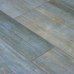 Barrique Blue Wood Plank Porcelain - This summer you're spending time at your cabin by the sea and before you move in for the season, you decide that the space needs a little redecorating. The walls get a refreshing coat of bright white paint, and you installed Blue Barrique wood plank porcelain flooring throughout. The light blue color of the porcelain tile is accented with tan streaks, giving the tile a genuine wood grain look. Not only does Blue Barrique wood plank porcelain look very much like hard wood flooring, but the texture of the tile is also very similar. Once the redecorating has been completed, you take a look around your sea side escape and couldn't be happier with you choice.