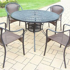 Oakland Living - 5-Pc Outdoor Dining Table Set - Includes one dining table and four stackable resin wicker chairs. Umbrella hole. Metal hardware. Fade, chip and crack resistant. Warranty: One year limited. Made from aluminum, steel and resin wicker. Black hardened powder coat finish. Minimal assembly required. Table: 48 in. Dia. x 29 in. H. Chair: 25.5 in. W x 23.25 in. D x 34 in. H (14 lbs.). Overall weight: 120 lbs.This dining set is the perfect piece for any outdoor dinner setting. Just the right size for any backyard or patio. The Oakland Sunray Collection combines contemporary style and modern designs giving you a rich addition to any outdoor setting. The traditional lattice pattern and scroll work is crisp and stylish. Each piece is hand cast and finished for the highest quality possible.
