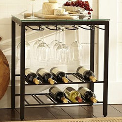 "Comstock Metal & Glass Floorstanding Wine Rack - Having our smart rack on hand makes entertaining easy in smaller spaces. It holds food and chilled wine up top and glasses and more wine below. 22.25"" wide x 13"" deep x 24"" high Made of iron with a blackened finish. Tempered-glass top. Holds ten bottles of wine. Holds up to fifteen stemmed wine glasses. Catalog / Internet only."