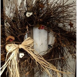 Country Birdhouse Wreath - Bring a dash of the outdoors inside with the Country Birdhouse Wreath. Complete with mini birdhouses colorful stars and various berries this classic decoration breathes a little bit of the country life into your home. Finished with a decadent raffia bow.