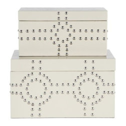 Z Gallerie - Bodega Storage Boxes Set of 2 - Storage so stylish that it dare not be relegated to the closet. Our set of two Sand Bodega Storage Boxes is designed exclusively for Z Gallerie, with a focus on utility but an eye on fashion for your home. These sturdy wooden boxes are covered in sophisticated sand leather-like embossed vinyl and finished with a distinctive design created from shiny nickel nail heads. The interiors are lined in black fabric, and the lids are secured with metal hinges at the back. To store larger items, check out our coordinating Bodega Storage Trunks.