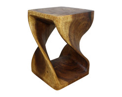 Kammika - Twist Stool 14x14x20 inch Height Sustainable Wood in E Friendly Livos Walnut Oil - Our Sustainable Monkey Pod Wood Twist Stool 14 inch x 14 inch x 20 inch height with Eco Friendly, Natural, Food-safe Livos Walnut Oil Finish is carved from sustainable Monkey Pod wood and is completely eco friendly. The beauty of this design lies in its simplicity. It is bold, yet gentle; rustic yet refined. One quarter twists support this piece, which can serve as an end table, stand or stool; they can serve as a serving table or bench when put together. This versatile piece is solid and reliable; each is hand carved - no two are alike. Craftspeople from the Chiang Mai area in Northern Thailand create these pieces with the simplest of tools. Each piece is a Work of Functional Sustainable Monkey Pod Wood Eco Friendly Art! After each sustainable Monkey Pod wood (Acacia, Koa, Rain Tree grown for wood carving) piece is kiln dried, and carved, it is rubbed in Livos Walnut oil creating a highly water resistant and food safe matte finish. The color ranges from medium to dark Walnut brown tones that will darken as the wood ages. There is no oily feel, and cannot bleed into carpets. We make minimal use of electric hand sanders in the finishing process. All products are dried in solar or propane kilns. No chemicals are used in the process, ever. This eco friendly functional art piece, made from the thick branches of the quick-growing Acacia tree in Thailand - where each branch is cut and carved to order (allowing the tree to continue growing), is packaged with cartons from recycled cardboard with no plastic or other fillers. As this is a natural product, the color and grain of your piece of Nature will be unique, and may include small checks or cracks that occur when the wood is dried. Sizes are approximate. Products could have visible marks from tools used, patches from small repairs, knot holes, natural inclusions or holes. There may be various separations or cracks on your piece w