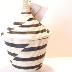 Agaseke Basket - These agaseke baskets are so uniquely shaped; they'd be sure to be a statement piece in any room! These are traditionally made for newlyweds, each one distinctly designed to represent something about the couple. They take five days to make, so you know they're truly a gift from the heart.