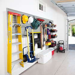 Flow Wall - Flow Wall 48 sq. ft. Garage and Hardware Storage System Multicolor - FWS-4812-12 - Shop for Garage Storage from Hayneedle.com! Storage System Includes: (12) 4 foot Slat-Wall Panels - Dimensions: 48W x 12H in. (48 square feet); Weight capacity of 100 lbs per square foot (4) 8 inch Long Hooks: Made of tensile steel with 13 gauge steel back plate the steel hooks are fully welded and powder coated. Dimensions: 8D x 2.5W in.; Weight capacity: 40 lbs (6) 4 inch Short Hooks: Made of tensile steel with 13 gauge steel back plate the steel hooks are fully welded and powder coated. Dimensions: 4D x 2.5W in.; Weight capacity: 50 lbs (1) Heavy Duty Dual Bracket Hook: Made of tensile steel with 13 gauge steel back plate the steel hooks are fully welded and powder coated. Dimensions: 9W x 8D x 2.5H in.; Weight capacity: 75 lbs (3) Ballistic Nylon Strap Hooks: Made of ballistic nylon with 13 gauge steel back plate the steel hooks are powder coated. Dimensions: Strap length - 19 in.; Weight capacity: 30 lbs (2) Jumbo Hard Bins: Bins are made of impact-modified fade resistant virgin polypropylene; Dimensions: 22W x 13D x 6H in.; Weight capacity: 55 lbs (3) Medium Hard Bins: Bins are made of impact-modified fade resistant virgin polypropylene; Dimensions: 11W x 14D x 6H in.; Weight capacity: 65 lbs (1) Soft Storage Bin: Made of strong and durable nylon mesh and steel frame. Dimensions: 24W x 12D x 12H in.; Weight capacity: 60 lbs About Flow Wall Put you workshop on the wall! We often hesitate to wall-mount equipment storage because it's just so permanent. The innovative Flow Wall system changes all that providing a simple system where shelves hooks cabinets bins and more simply switch places at will. By placing a custom-shaped Flow Wall where there was none you've opened up a world of possibilities without locking yourself into one design. Perfect for the laundry room rec room garage workshop class room craft area and so much more Flow Wall is the answer when your back's u