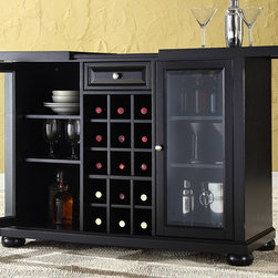 Crosley Furniture - Sliding Top Bar Cabinet - Sliding expandable top. Beveled and tempered glass doors. Raised front panel drawer. Adjustable shelves and plentiful storage space for spirits, appliances and other items. Center storage area great for up to fifteen bottles of wine. Can remove wine storage cubes to reveal an adjustable shelf. Brushed nickel hardware. Doubles as a serving station when entertaining. Adjustable levelers in legs. ISTA 3A certified. Warranty: 90 days. Made from solid hardwood and wood veneers. Hand rubbed black finish. Assembly required. 64 in. W x 20 in. D x 36 in. H (220 lbs.)Elegantly entertain guests with this sliding top bar cabinet Style, function and quality make this sliding top bar cabinet a wise addition to your home.