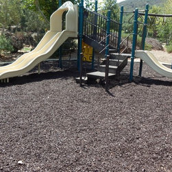 Playground Surfacing with Rubber Mulch - Safety and convenience are what our Rubber Mulch installation is all about. Because it won't blow away, wash away or get packed down, the hassle of reapplying ground cover year after year is minimized. Cost effective, ours lasts at least 8 times longer than traditional playground mulch.