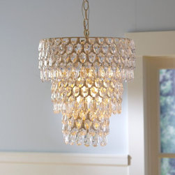Teardrop Chandelier - This may be a bit out there, but I think a fun, retro-inspired crystal chandelier would be such an unexpected surprise for overhead lighting in a playroom. Balancing out kiddie and adult style will make the room something you all can enjoy.