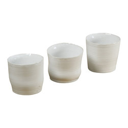 Montes Doggett - Hand-thrown Tumblers, Set of 3 - The organic shapes of these ceramic tumblers add personality and natural beauty. You could serve drinks in these or even display a cluster of wildflowers. Either way, they will add an eclectic elegance when you entertain.