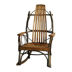 Pre-owned Vintage Bentwood & Twig Rocking Chair - This rustic, handcrafted, wooden rocking chair showcases a bit of both Adirondack and Twig furniture styles. It has an oak slat seat and backrest, sturdy armrests, and beautiful bentwood hickory flair. This outdoor rocking chair would work perfectly on a covered porch but could work equally well indoors.    One ornamental piece of hickory has broken off on the back of the rocker, but otherwise it's in good condition.