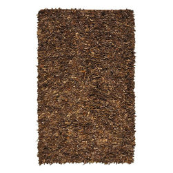 Home Decorators Collection - Leather Shag Area Rug - Unlike most shag rugs, our Leather Shag Area Rug is crafted of strips of suede leather that are hand tufted to a sturdy backing. Its suede leather construction creates a plush texture (your feet will thank you). Make your room more comfortable with the look and feel of a shag rug. No two rugs are alike due to the handcrafted design. Hand tufted of suede leather. The simple colors complement various design themes.