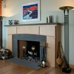Wave House Mantel - A contemporary mantel design made from FSC certified Europly and Douglas fir is paired with a slate hearth and mantel shelf. Designed by the owner/architect, the subtle arch in the mantel wood is a feature carried throughout The Wave House.