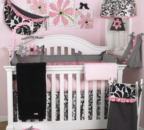 Cotton Tale Designs - Girly 8 Piece Crib Bedding Set - A quality baby bedding set is essential in making your nursery warm and inviting. All Cotton Tale patterns are made using the finest quality materials and are uniquely designed to create an elegant and sophisticated nursery. The Girly 8 Piece Set includes the 4 pc crib bedding(dust ruffle, fitted crib sheet, comforter, and bumper), diaper stacker, valance, toy bag, and pillow pack. What could be cuter than this adorable set Girly, in pink and black. Sweet, bright pink dot trim with contemporary floral and furry curly Q fleece coverlet in black. The bumper is a combination of big floral black pin dot and bias stripe black & white trimmed in a bright pink ruffle. Sheet in pink skin with black and white dust ruffle, pink bias trim. The Girly diaper stacker bias in black and white stripe, with pink bias ruffle. Holds up to 4 dozen diapers. Fun and functional. Never tie on the crib. The Girly valance is so adorable. The top yoke of the valance is in black and white bias strip and measures 37 inches wide. The bottom shirred floral measures 54 inches. Length of valance is 17. Girly pillow pack contains 3 pillows measuring in 10x10, 12x12, and 15x15 inches in size. Pillows should never be placed inside the crib. The Girly toy bag can be used as wall decor or tied on changer to store supplies. Functional and fun, can store toys or supplies. never tie to the crib. 100% cotton twill with poly fill. This is a smashing nursery for your baby girl. 100% cotton twill. Wash gentle cycle, separately in cold water. Tumble dry low or hang dry.
