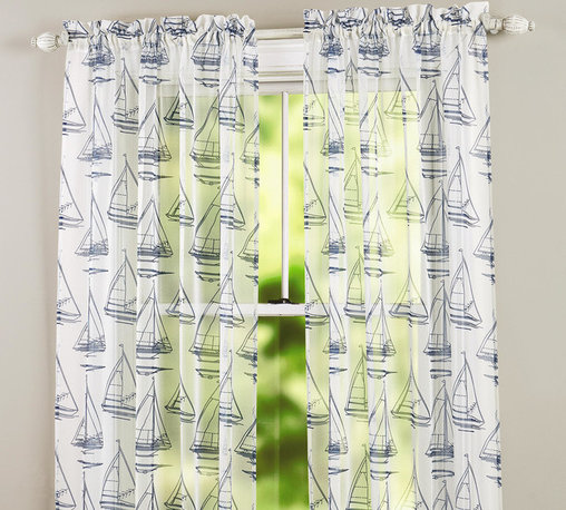 Navy Sailboat Sheer Window Panel - These incredibly affordable sheers (just $5 a panel!) would work really well in an otherwise neutral boys' room. I could see them layered over a solid curtain as well.
