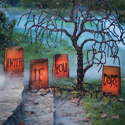 """Grandin Road - Enter If You Dare Halloween Luminaries - Grandin Road - long-lasting mini lights imbue each with an eerie glow from within. luminarias connect end-to-end and plug into any standard outlet. Constructed from all-weather fabric over vinyl. Put the neighbors on notice with giant pre-lit Enter If You Dare Luminaries. Each bag in this set of 4 measures a can't-miss 20""""H, so would-be visitors are sure to get the message. Long-lasting mini lights imbue each with an eerie glow from within . Luminarias connect end-to-end and plug into any standard outlet .  . Sturdy ground stakes included."""