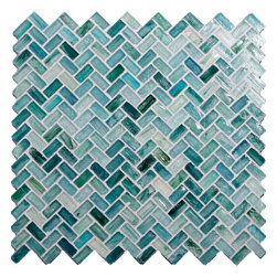 "Glass Tile Oasis - Seaside Herringbone Blue Pool Glossy Glass - Sheet size:  Approx .99 Sq. Ft.     Tile Size:  1/2"" x 1""     Tiles per sheet:  64     Tile thickness:  1/4""     Recycled Components:   70%     Sheet Mount: Paper Face    Sold by the sheet    -  Waterfall glass tiles are each a one of a kind work of art. Each style features complimentary colors  shot through with transparent layers of contrasting colors. Mosaics are stacked together creating a unique repeating pattern.Waterfall are hand-poured and will have a certain amount of variation and variegation of color  tone  shade and size. Additionally  you will notice creases  wrinkles  shivers  waves  bubbles topped off with a natural surface to catch all forms of light for a brilliant effect. These characteristics of natural glass only serve to enhance the final beauty of the installation."