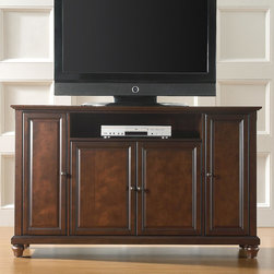 """Crosley - Cambridge 60"""" TV Stand - Enhance your living space with one of Crosley's impeccably-crafted TV stands. This signature cabinet accommodates most 60'' flat panel TVs and is handsomely proportioned featuring character-rich details sure to impress. Raised panel doors strategically conceal stacks of CDs/DVDs, gaming components and various media paraphernalia. Open storage area generously houses media players and the like. Adjustable shelving offers an abundance of versatility to effortlessly organize by design, while cord management systems tame the unsightly mess of tangled wires. Customize our distinct cabinets by selecting one of four collection styles (featuring tapered, traditional. turned or bun feet) in your choice of one of three signature Crosley finishes. This customizable cabinet approach is designed for easy assembly, built to ship and constructed to last. Features: -Raised panel doors.-Five adjustable shelves for storing electronic components, gaming consoles, DVDs and other items.-Adjustable levelers in legs.-Recommended TV Type: Flat screen.-TV Size Accommodated: 60"""".-Powder Coated Finish: No.-Gloss Finish: No.-Material: Hardwood and veneers.-Solid Wood Construction: No.-Distressed: No.-Exterior Shelves: Yes -Number of Exterior Shelves: 1.-Adjustable Exterior Shelves: No..-Drawers: No .-Cabinets: Yes -Number of Cabinets: 3.-Number of Doors: 4.-Door Attachment Detail: Pin hinge.-Interchangeable Panels: No.-Magnetic Door Catches: Yes.-Cabinet Handle Design: Knob.-Number of Interior Shelves: 5.-Adjustable Interior Shelves: Yes..-Scratch Resistant : No.-Removable Back Panel: No.-Hardware Finish (Finish: Black): Brushed nickel knobs, steel hardware.-Hardware Finish (Finish: Classic Cherry, Vintage Mahogany): Antique brass knobs, steel hardware.-Casters: No .-Accommodates Fireplace: No.-Fireplace Included: No .-Lighted: No .-Media Player Storage: Yes.-Media Storage: No .-Cable Management: Hole in back for wires.-Remote Control Included: No.-Batteries R"""